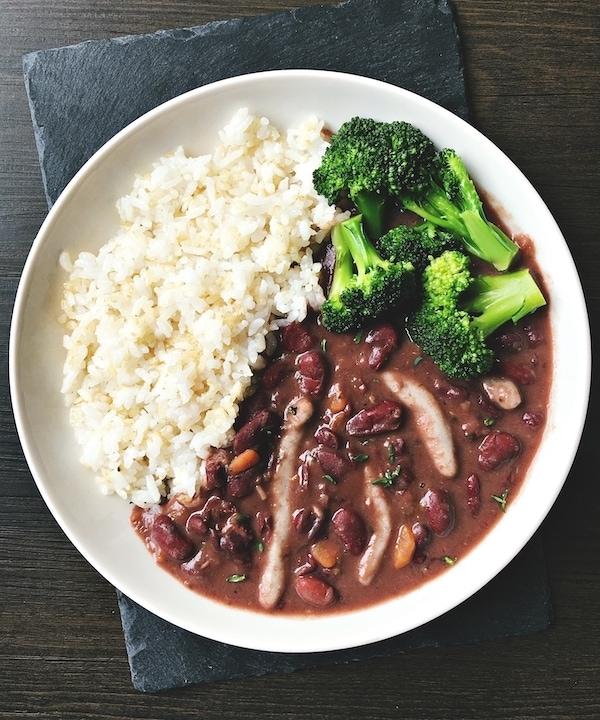 vegan stew peas with rice and broccoli in a bowl