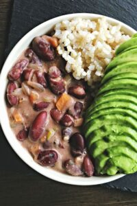 Vegan jamaican red bean stew with avocado