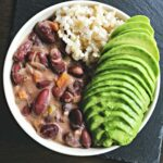 vegan stew peas with rice and avocado in a bowl