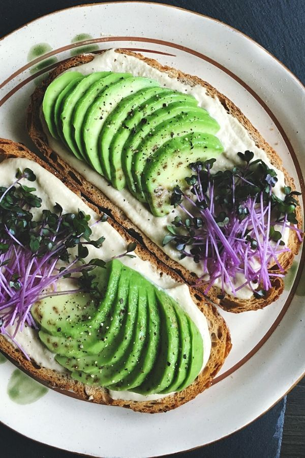 hummus avocado red cabbage sprouts on sourdough