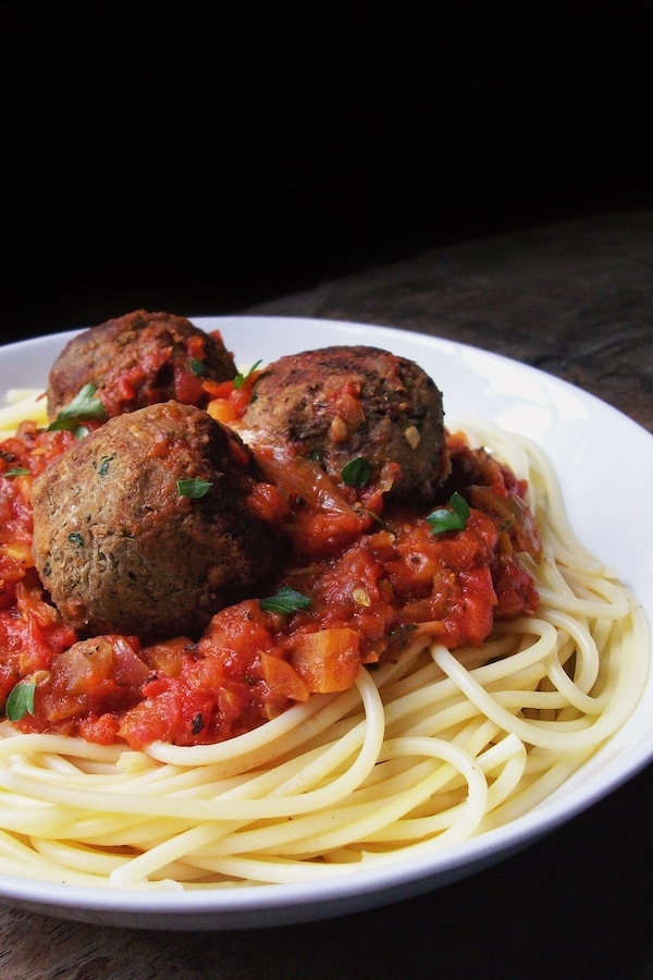 vegan mushroom lentil meatballs with pasta in a bowl