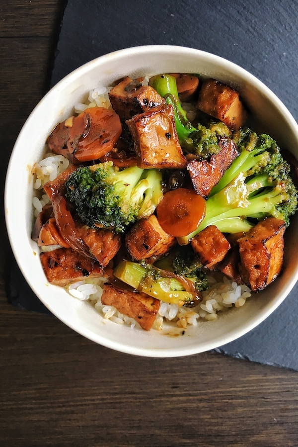vegan teriyaki tofu with broccoli carrots and rice in a bowl