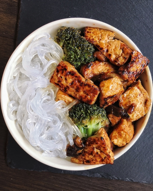 vegan tofu teriyaki stir fry with broccoli and japanese noodles in a bowl