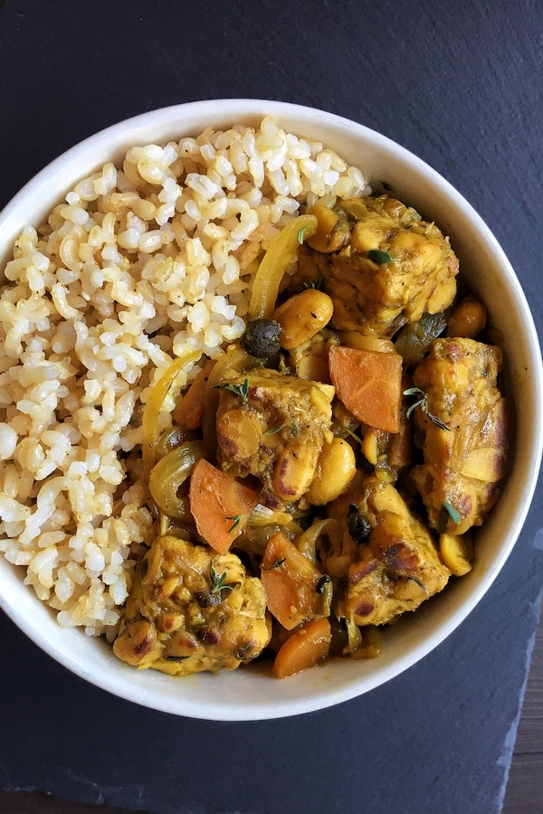 jamaican tempeh curry with rice in a bowl