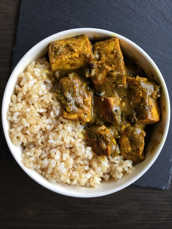 jamaican tofu curry with rice in a bowl