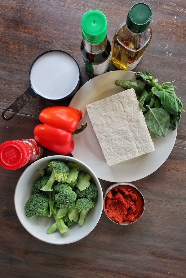 ingredients for thai red tofu curry on table