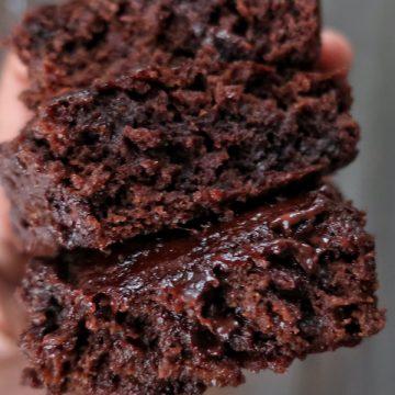 hand holding three gluten free vegan brownies
