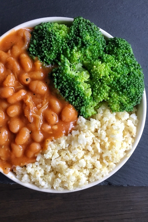 millet baked beans and broccoli in a white bowl