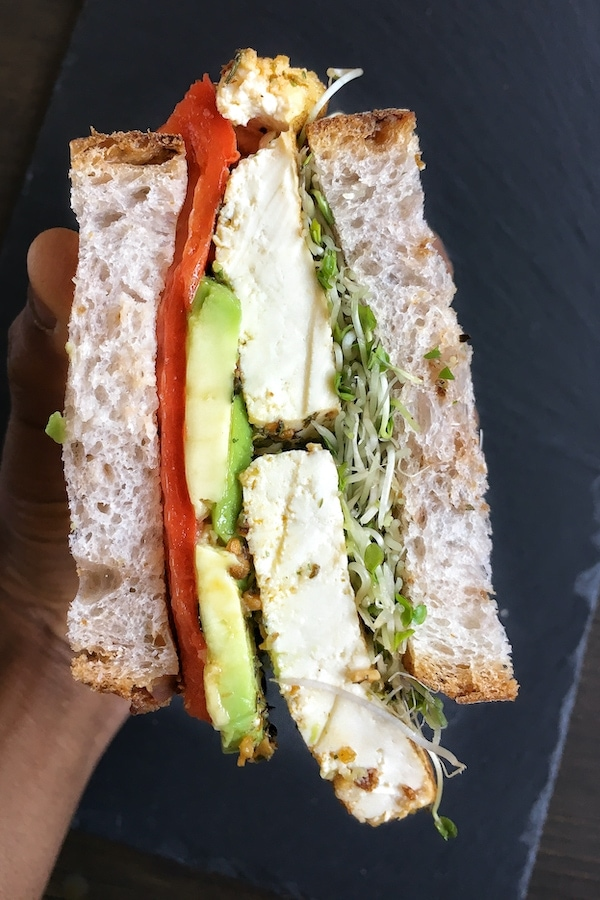baked tofu sandwich with roasted pepper and avocado