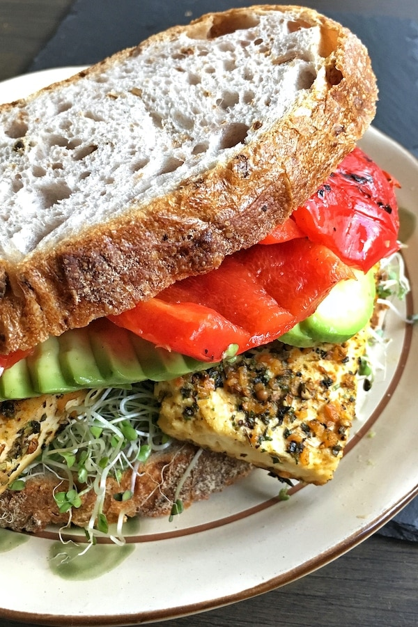 garlic and herb baked tofu sandwich with red pepper