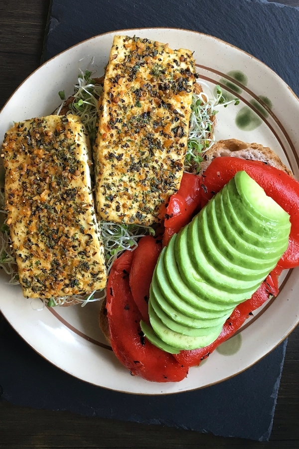 garlic and herb baked tofu with roasted red pepper and avocado