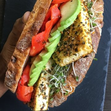 vegan baked tofu sandwich with roasted red bell pepper