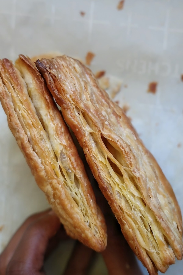 vegan puff pastry in hands on parchment paper