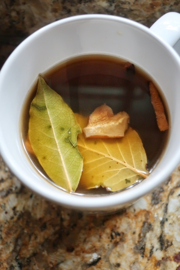 dried shiitake mushrooms and bay leaf in vegan broth